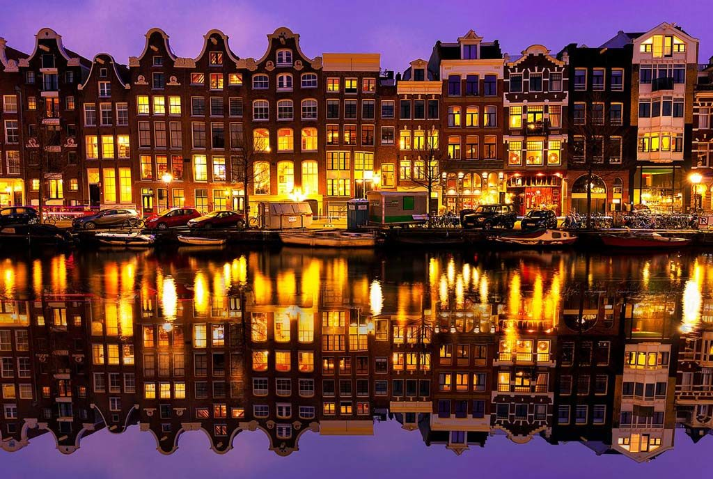 The welcoming lights of the houses facing Amsterdam's canals.
